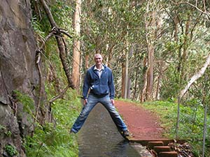 Manfully straddling a levada on holiday in Madeira