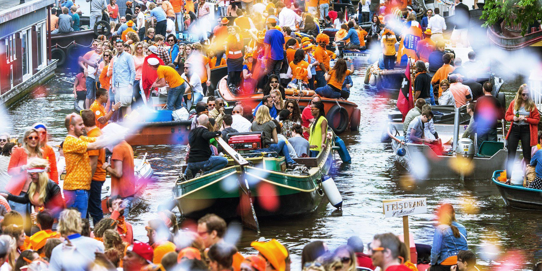Parties on the canal for Kings Day in Amsterdam