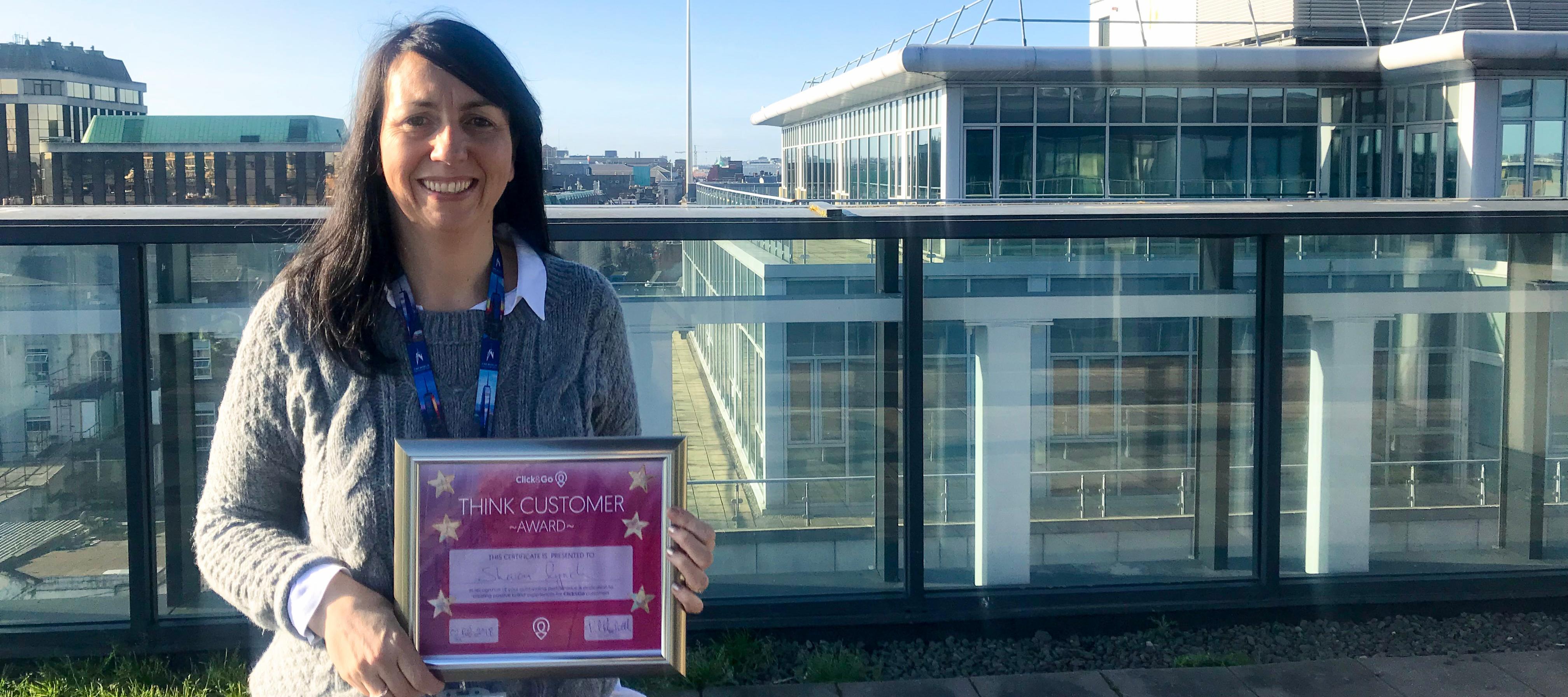 Sharon with the inaugural Think Customer Award