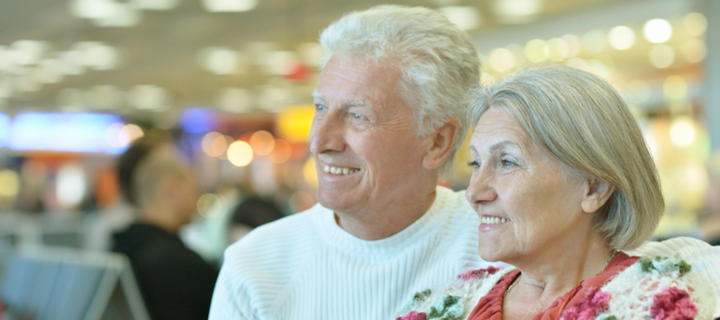 Older couple in airport | Over 50s Holidays Flights and Transfers