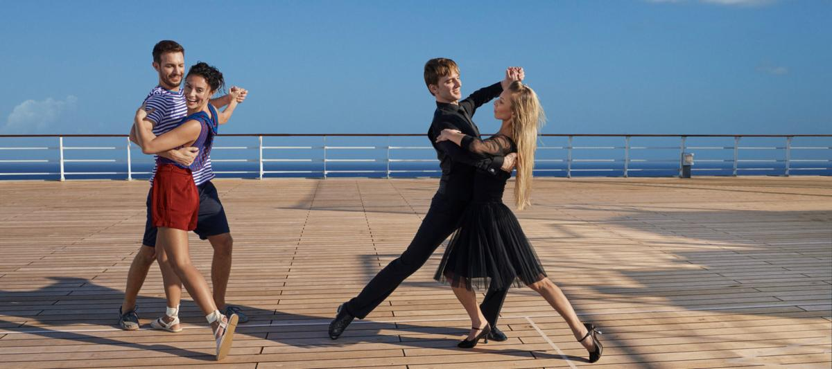 Dance lesson on upper deck | The Cunard Experience