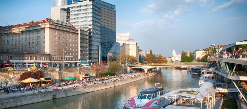 People socialising along the Danube in Vienna