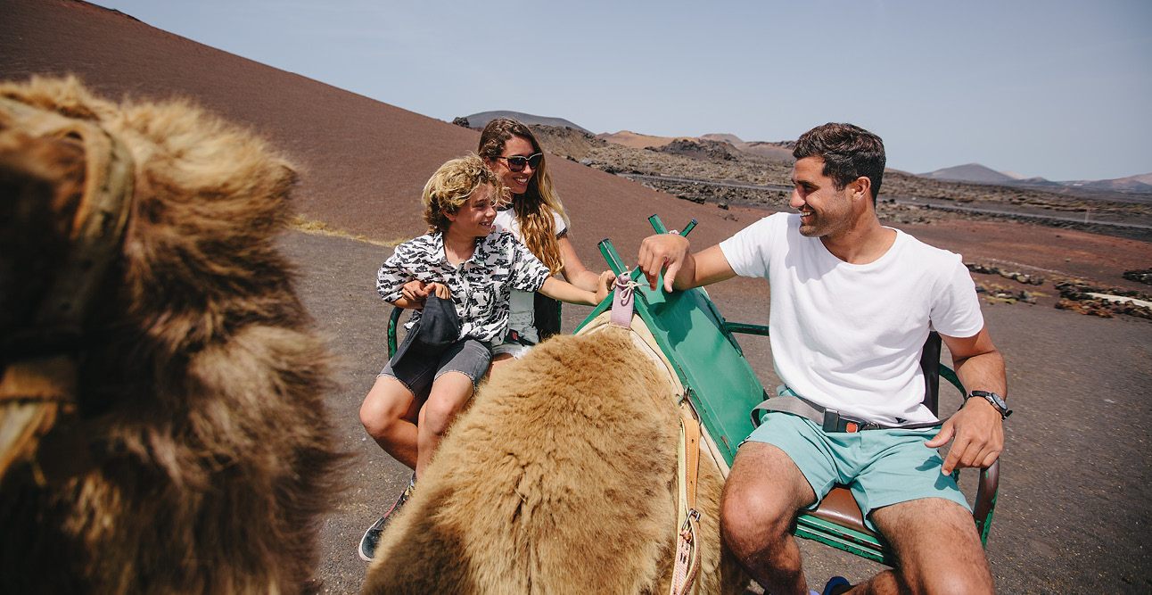 Family riding camels in Timanfaya National Park in Lanzarote | 7 Reasons to Visit Lanzarote