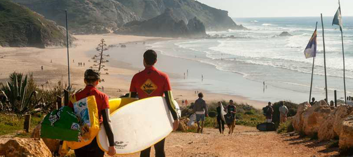 Surfers heading to the beach in the Algarve