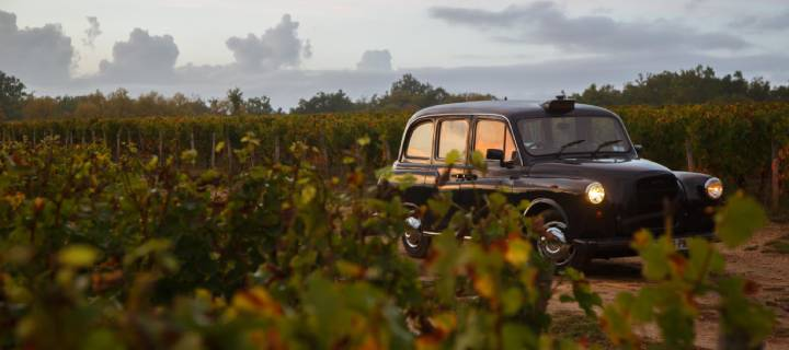Black cab driving through a vineyard - Wine Cab Tours in Bordeaux