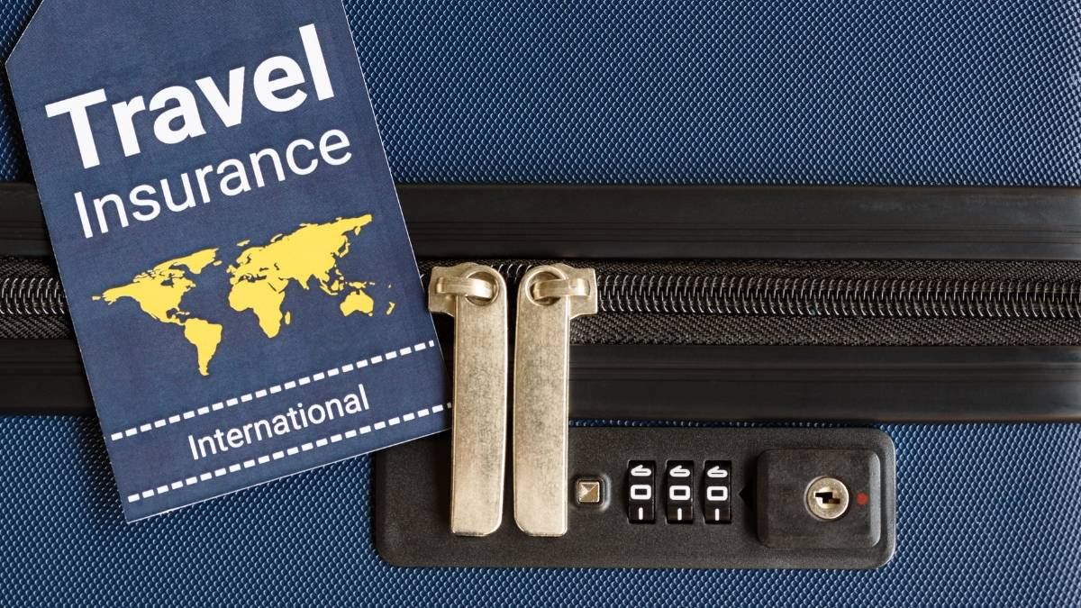 Travel insurance label on a suitcase